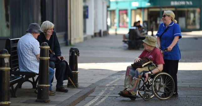 People employ social distancing as they chat in the street in York in northern England on May 28, 2020, during the COVID-19 pandemic. - Britain has suffered the highest death rate from the coronavirus among the most-affected countries with comparable tracking data, according to Financial Times research published Thursday. (Photo by Oli SCARFF / AFP) (Photo by OLI SCARFF/AFP via Getty Images)