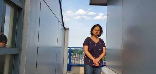 Picture of Ritu Saha next to her building