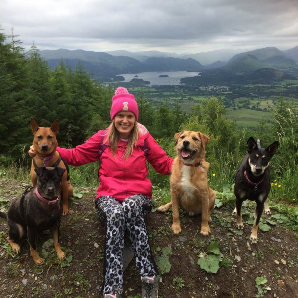 Victoria Bryceson in the forest with three of her dogs