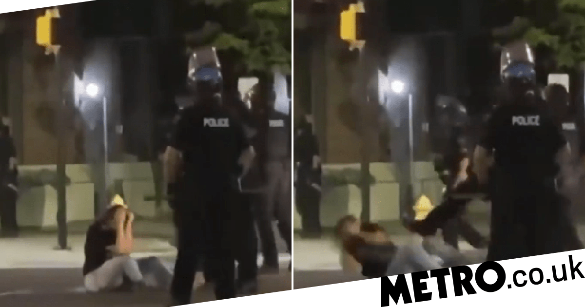 Moment cop kicks George Floyd protester on the ground after pepper-spraying her - metro