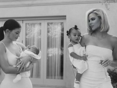 Kylie Jenner cuddles up to Kim Kardashian's kids in cute throwback photo as famous family stays separated in lockdown