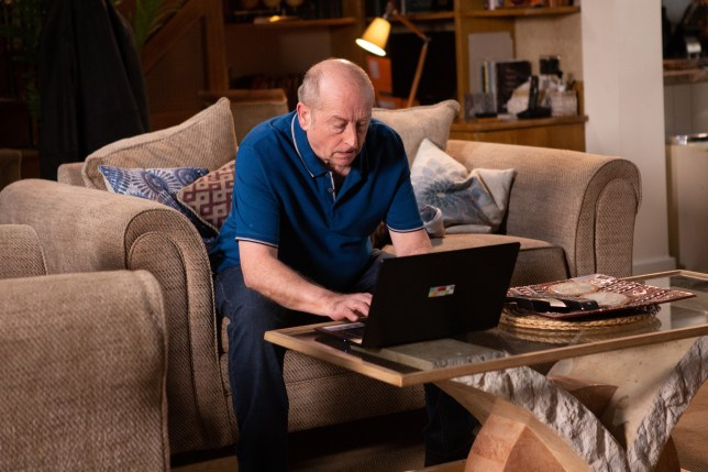 Geoff Metcalfe at his laptop in Coronation Street