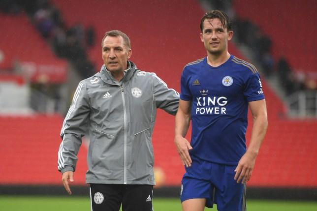 Brendan Rodgers stands alongside Leicester left-back Ben Chilwell