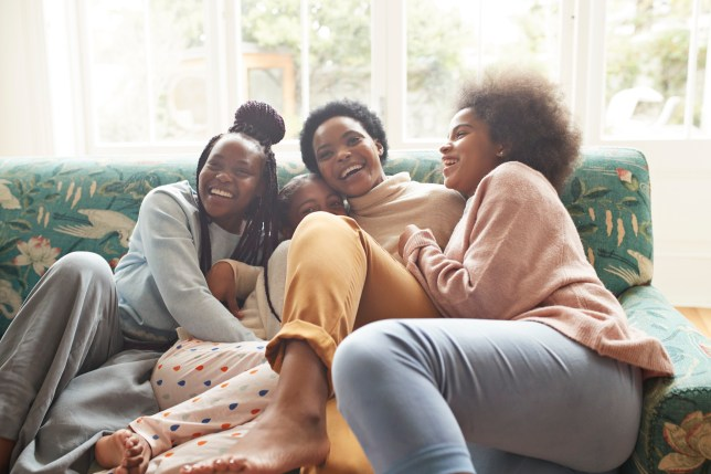 smiling women on a sofa