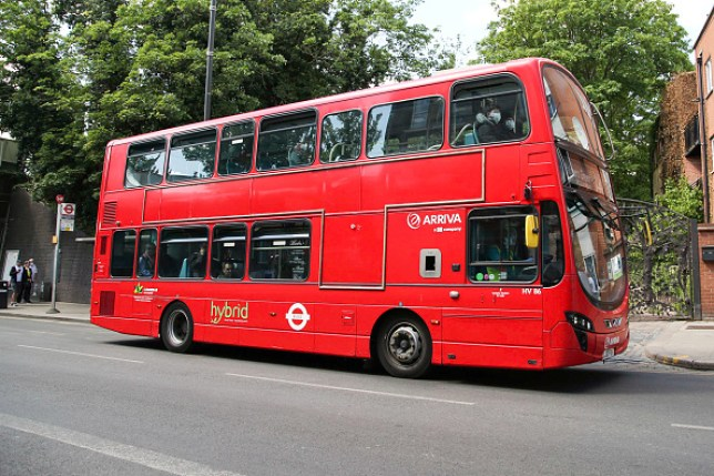 Passengers on a London bus wearing face coverings