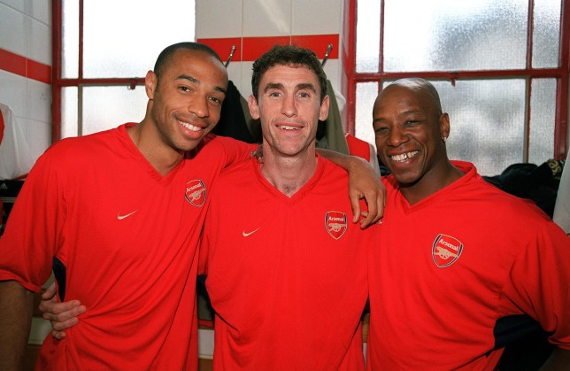 Arsenal legends Thierry Henry, Martin Keown and Ian Wright pose in the dressing room
