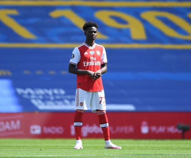 Bukayo Saka looks on during Arsenal's defeat to Brighton in the Premier League