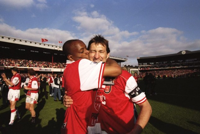 Arsenal legend Ian Wright kisses Tony Adams on the cheek