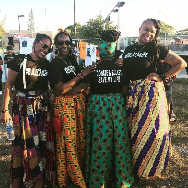 Takieyah, pictured second left with friends, is now a campaigner against gun violence.
