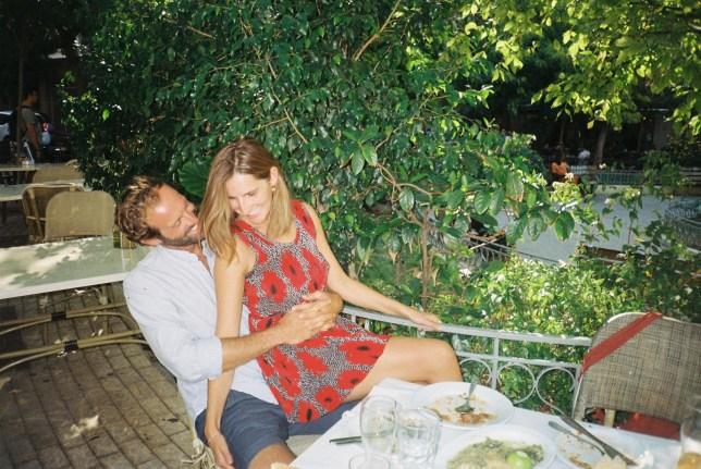 Anastasia Miari and her fiance sat together hugging