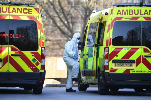 ambulance crew in hazmat gear amid coronavirus pandemic