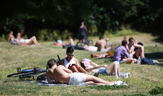 epa08458609 People enjoy the warm weather at a park in London, Britain, 01 June, 2020. The British government has stated from 01 June that six people can now meet together at a park or private garden as lockdown continuers to ease. Countries around the world are taking increased measures to stem the widespread of the SARS-CoV-2 coronavirus which causes the Covid-19 disease. EPA/ANDY RAIN