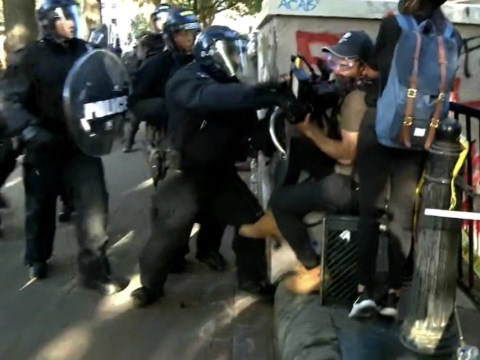 Cameraman smashed in the stomach with riot shield during George Floyd protest