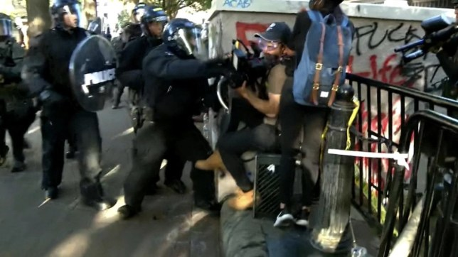 Police smash cameraman in the stomach with riot shield during George Floyd protest