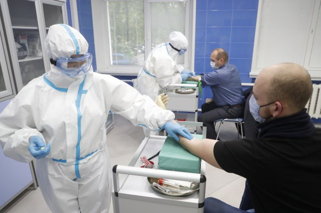 Medical specialists draw blood to test for COVID-19 coronavirus antibodies at the 191 hospital in Moscow, Russia