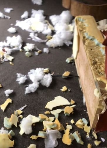 This is the moment a shocked owner discovered his pet dog had destroyed his new £2,800 sofa - when he found the stuffing scattered across his living room