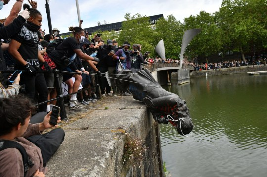 Protesters throw statue of Edward Colston into Bristol harbour during a Black Lives Matter protest