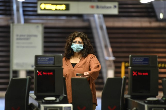 commuters wearing face masks