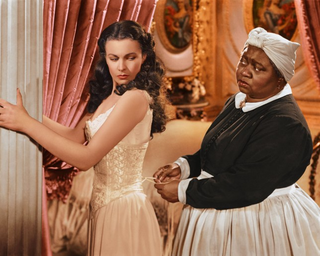 Vivien Leigh has her corset tightened by Hattie McDaniel in Gone with the Wind