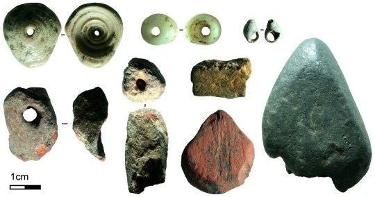 Some of the symbolic artefacts recovered from Fa-Hien Lena, Sri Lanka. Here you can see shell beads and different pigments in bright red, yellow, and silver which were used to decorate bodies or items. (Credits: M. C. Langley / SWNS)