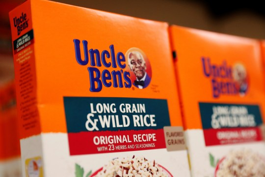 Boxes of Uncle Ben's branded rice stand on a store shelf inside of a shop