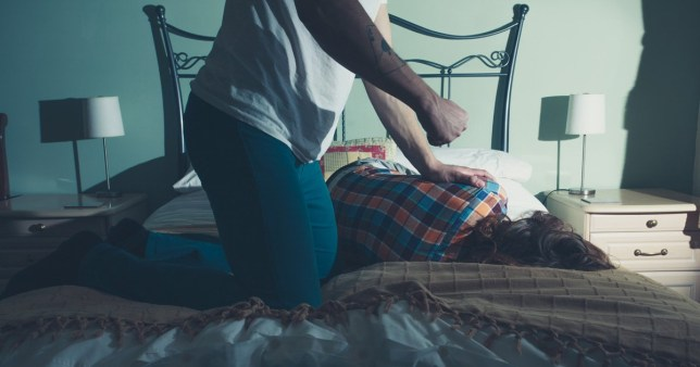 Rough sex defence banned - A man is beating his wife on a bed