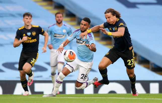 MANCHESTER, ENGLAND - JUNE 17: David Luiz of Arsenal battles for possession with with Riyad Mahrez of Manchester City which leads to a penalty for Manchester City and a red card for David Luiz during the Premier League match between Manchester City and Arsenal FC at Etihad Stadium on June 17, 2020 in Manchester, United Kingdom. (Photo by Matt McNulty - Manchester City/Manchester City FC via Getty Images)
