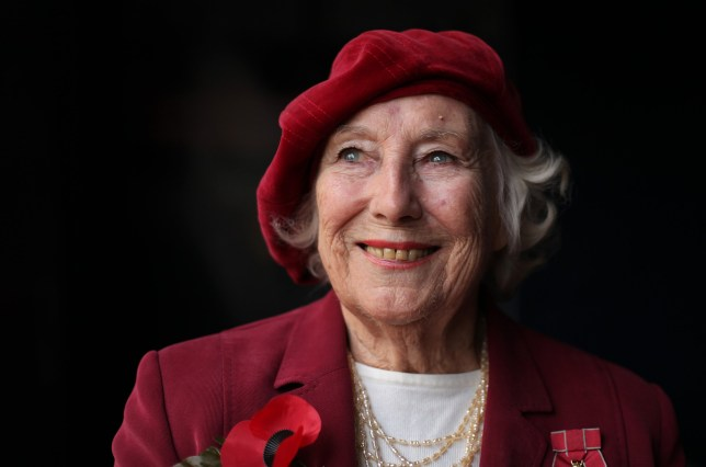 Forces sweetheart Dame Vera Lynn poses for photographs in central London, on October 22, 2009. Forces sweetheart Dame Vera Lynn on Thursday joined soprano singer Hayley Westenra for an emotional rendition of the classic wartime song We'll Meet Again to officially launch the Royal British Legion's poppy appeal. AFP PHOTO/Shaun Curry (Photo credit should read SHAUN CURRY/AFP via Getty Images)