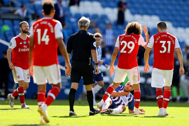 Arsenal's Matteo Guendouzi, 2nd right, gestures at Brighton's Neal Maupay