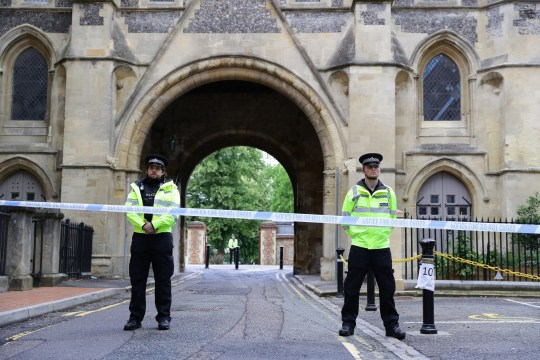 READING, ENGLAND - JUNE 21: Police guard an entrance to Forbury Gardens on June 21, 2020 in Reading, England. A lone attacker targeted groups of people socialising in Forbury Gardens stabbing them in the neck. Despite counter-terrorism police raiding a block of flats in the city last night, police now say the attack was not terror-related. Three people have died and two are in serious condition in the Royal Berksire Hospital. A 25-year old man was arrested at the scene. (Photo by Richard Heathcote/Getty Images)