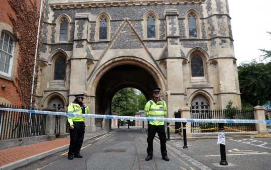 Police stand guard at the Abbey gateway of Forbury Gardens, a day after a multiple stabbing attack in the gardens in Reading, England, Sunday June 21, 2020. British police say they are treating a stabbing rampage in a park that killed three people as a terrorist attack. Dean Haydon, the U.K.???s coordinator of counterterrorism policing, said counterterror detectives were taking over the investigation into the attack in the town of Reading, west of London. (AP Photo/Alastair Grant)