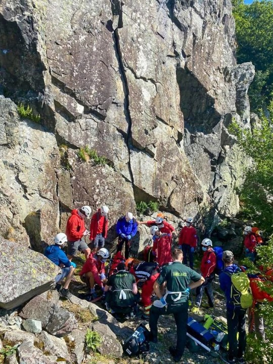 The young man being carried on a stretcher by rescue teams. A 19-year-old mountain climber was miraculously saved by his helmet after plunging 26 feet while rock climbing at Shephers Crag, in the Lake District.