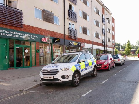 Pair arrested on suspicion of murder after man falls from balcony and dies