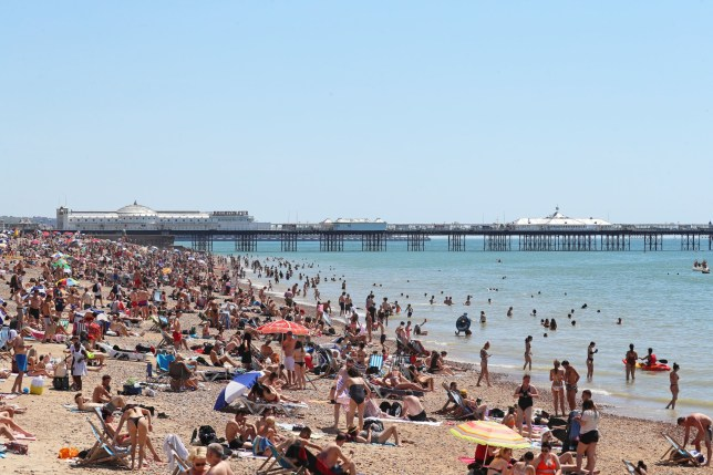 People enjoy the warm weather on Brighton beach as Thursday could be the UK's hottest day of the year with scorching temperatures forecast to rise even further. PA Photo. Picture date: Thursday June 25, 2020. See PA story WEATHER Hot. Photo credit should read: Gareth Fuller/PA Wire