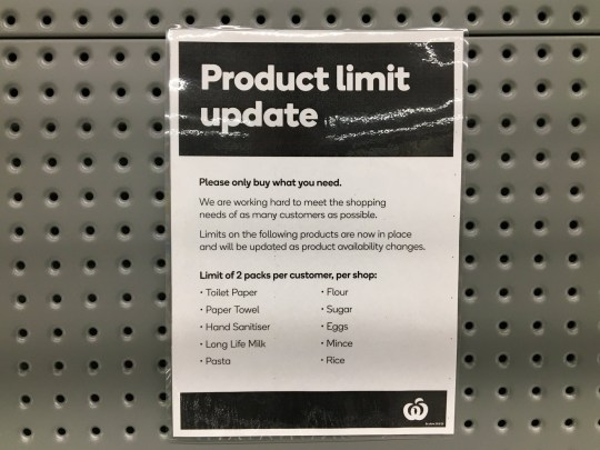 epa08509884 Signage for product limits sits on a toilet paper shelf in a Woolworths Supermarket in Melbourne, Australia, 26 June 2020. People are panic buying more toilet paper as coronavirus cases surge in Melbourne. EPA/JAMES ROSS AUSTRALIA AND NEW ZEALAND OUT