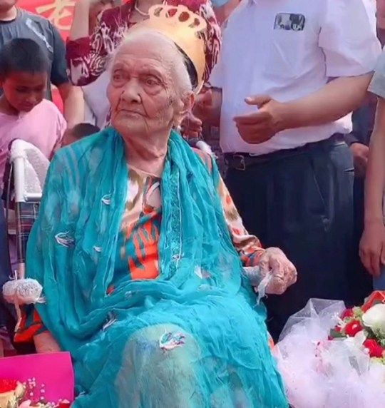 Pics Shows: Almihan Seyiti, born 1886, celebrates her 134th birthday in Shulan, Xinjiang, China, on 25 June 2020; This is the woman born during the Qing Dynasty who Chinese officials are calling the world???s oldest as they celebrate her 134th birthday.