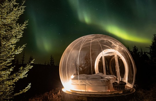 bubble hotel under the northern lights in iceland