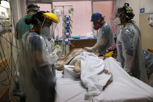 Health workers take care of a patient infected with the coronavirus disease (COVID-19) inside an Intensive Care Unit of the Posta Central hospital in Santiago, Chile, June 9, 2020. Picture taken June 9, 2020. REUTERS/Ivan Alvarado