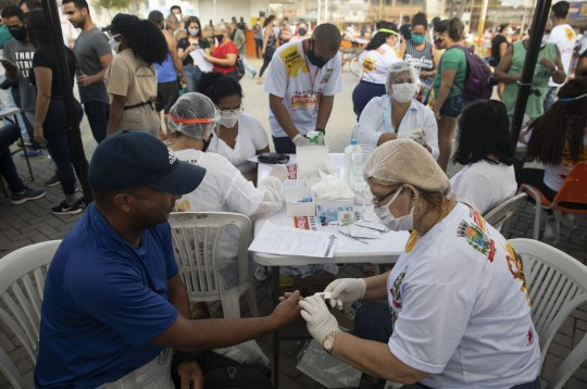 Mandatory Credit: Photo by Fernando Souza/ZUMA Wire/REX (10693571l) People attend the mass testing of Covid19, the new corona virus, in the municipality of Belford Roxo, in the metropolitan region of Rio de Janeiro, Brazil. Yesterday, the country recorded 1,315,941 cases and 57,103 deaths from Covid-19, with 994 deaths reported in the last 24 hours. Mass Testing of Covid19 in Rio de Janeiro, Brazil - 27 Jun 2020