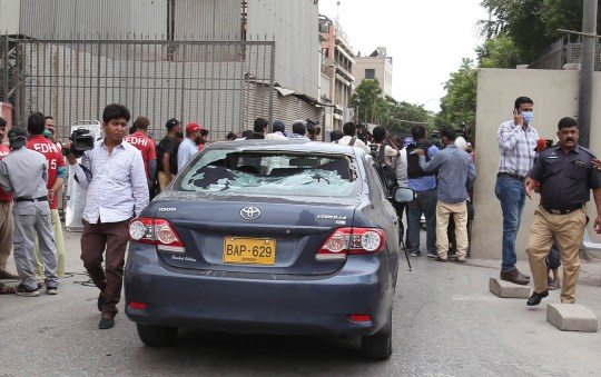 epa08515325 Pakistani security officials inspect the scene of an attack by unknown gunmen at Karachi Stock Exchange in Karachi, Pakistan, 29 June 2020. At least four gunmen and two civilians were reportedly killed and security forces have cordoned off the area as fighting is currently ongoing. EPA/REHAN KHAN