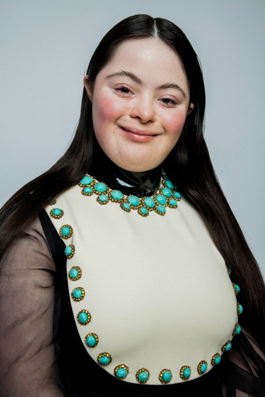 Ellie who has Down's Syndrome modelling