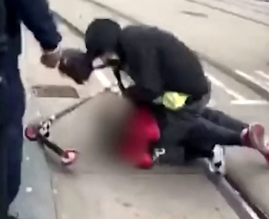 Shocking video footage showing thugs savagely assaulting a defenceless man as he cowered on the floor in Birmingham city centre yesterday (28 June). See SWNS story SWMDbeating. The 40-year-old man was set upon in Corporation Street at around 6pm and robbed of his wallet and keys. He was left with nasty head injuries and needed hospital treatment to a badly bruised eye and possible fractures after one of the offenders stamped on his head. The shocking footage shows several people witnessing and filming the incident.c