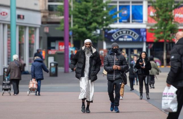 People walking through Leicester