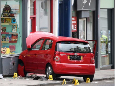 Boy, 3, dies after car mounts pavement and crashes into shop