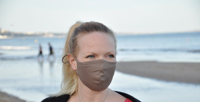 A blonde woman wearing the Thyra mask made from recycled nylon