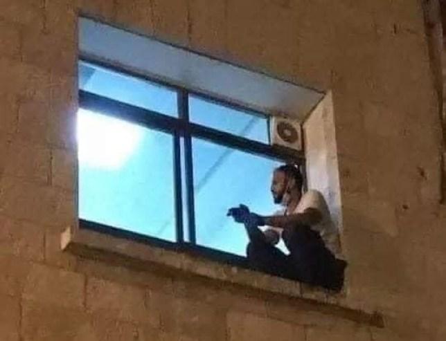 Man watching mum through window