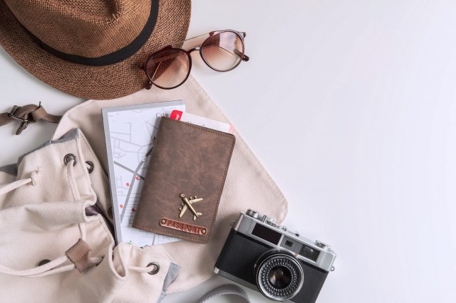 Flatlay of backpack with camera and passport inside