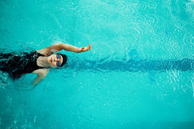 View from directly above a paraplegic woman training in a pool
