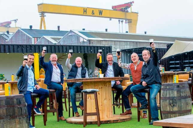 Locals toast the opening of new outdoor pub.