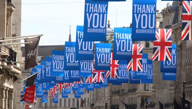 Thank You banners and Union Jack flags hang across Oxford Street in London